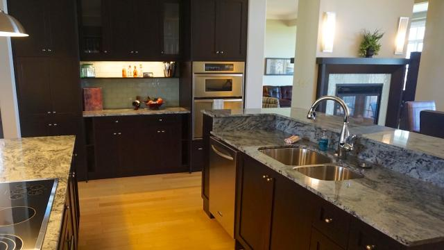 A kitchen in one of the Harb'r Stone Village townhomes at Fox Harb'r Resort