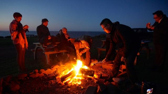 A campfire on the shore of the Northumberland Strait ends a day at Fox Harb'r
