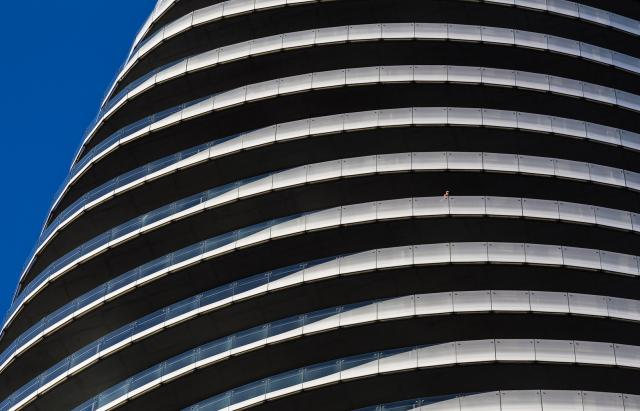 Resident on a balcony at Absolute World in Mississauga, image by Matt via Flickr