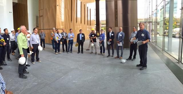 Mark Garland of LCL Builds welcomes the tour group to the building, image by Jam