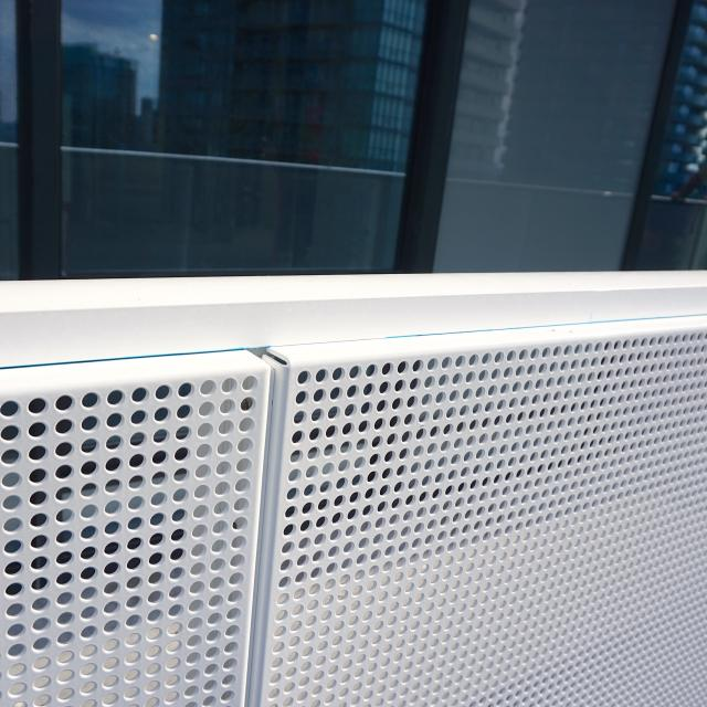 Balcony guards are a powder coated perforated aluminum, One York, Toronto