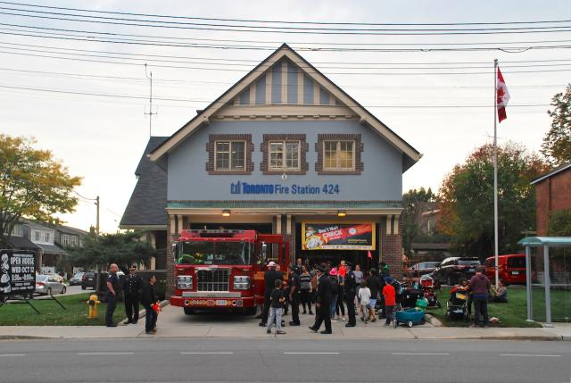 A crowd gathers in front of Fire Station 424, Toronto, Runnymede