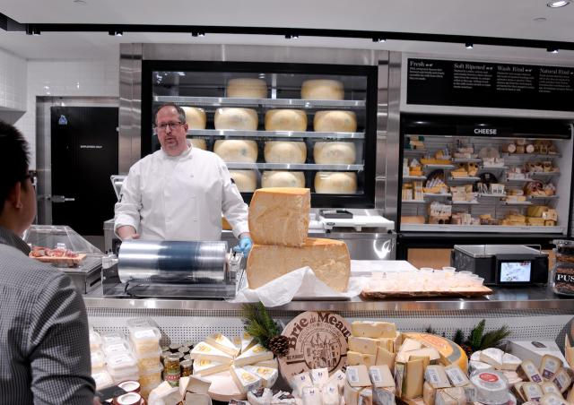 The cheese counter features high-end products from around the world, image by Al
