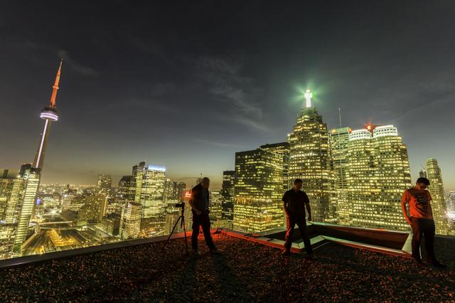 Rooftoppers in Toronto, image by Flickr user Freaktography via Creative Commons