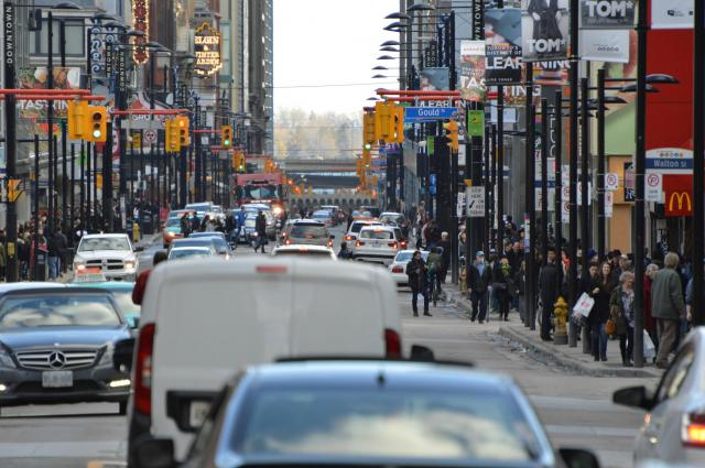 Pedestrians and cars on Yonge Street, image by UT Flick contributor Greg's South