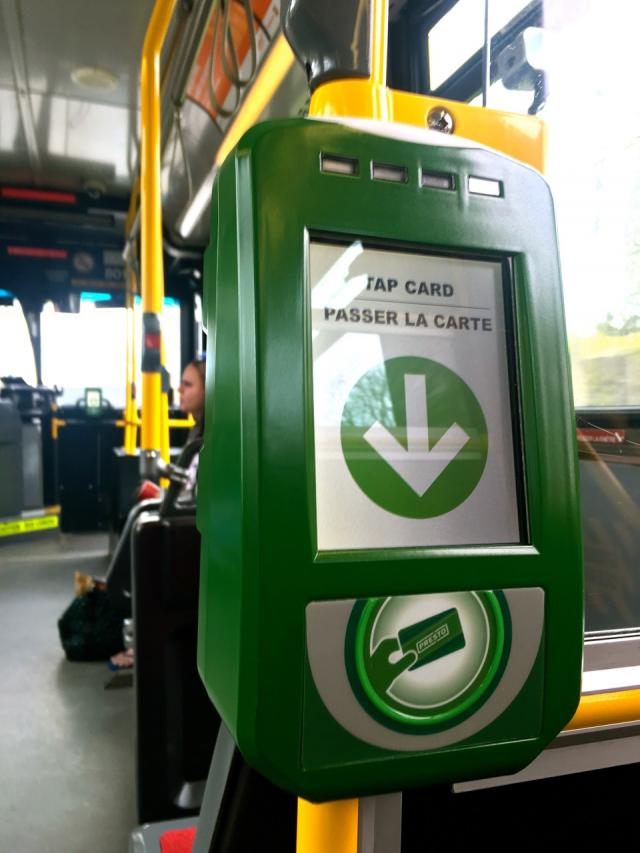 Presto reader mounted at the rear doors of a TTC bus, uncommon on other GTHA sys