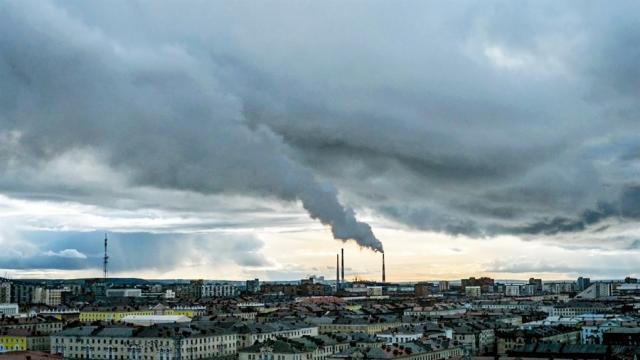 A foreboding sky over the city of Norilsk, Russia, in A Moon of Nickel and Ice,