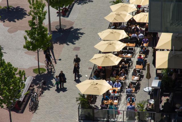 Aerial view of sidewalk patio at Against the Grain restaurant, image by UT Flick