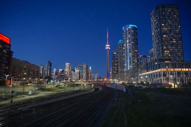 The CN Tower, the Toronto skyline, and Concord CityPlace glow by night, CTBUH