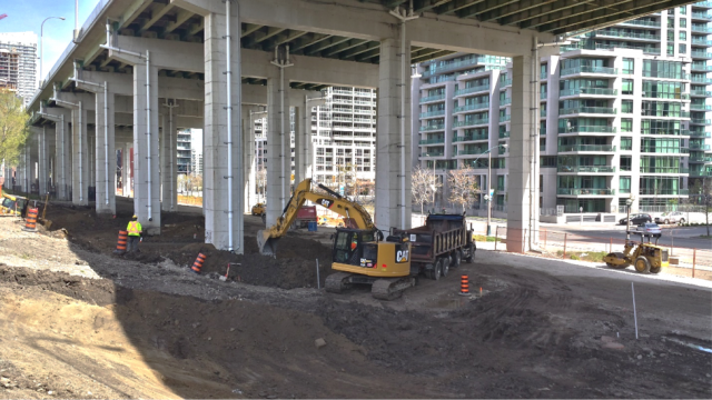 Crews excavating to install the future skating trail, Waterfront Toronto