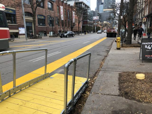 New yellow platform edge strips at a King streetcar stop