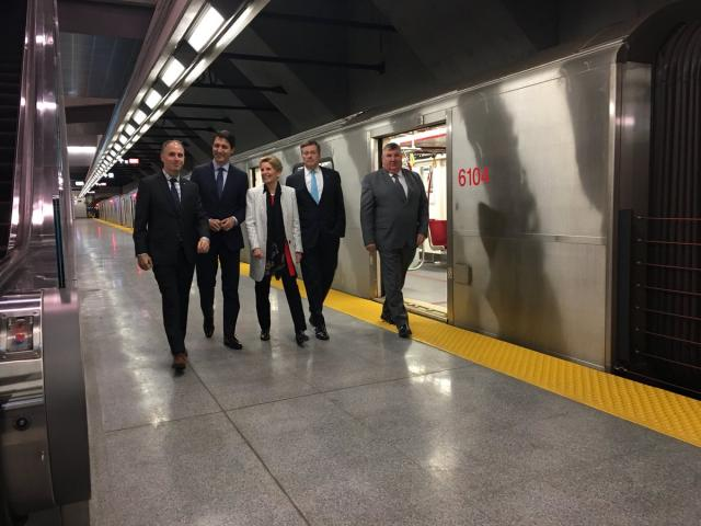 Colle, Trudeau, Wynne, Tory, and Emmerson walk the platform at VMC station, imag