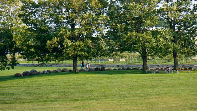 Shade provides places for picnics while stone wall define parkland settings, ima