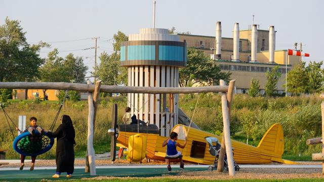 An aviation-themed playground looks towards some of the base's older buildings,