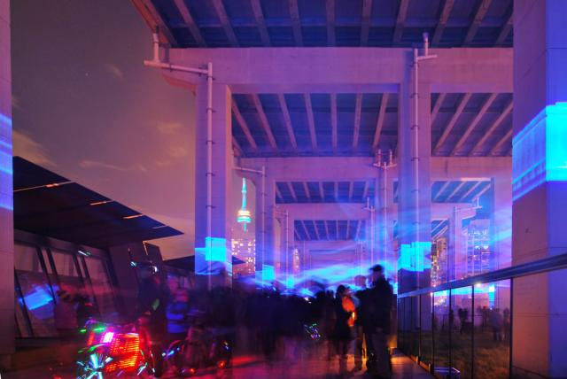 Looking east through Daan Roosengaarde's Waterlicht installation at The Bentway