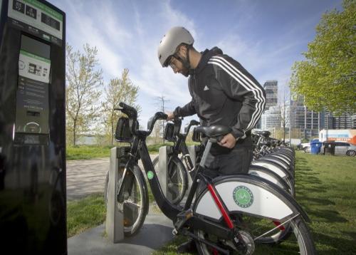 Loading a BikeShare bike into a station