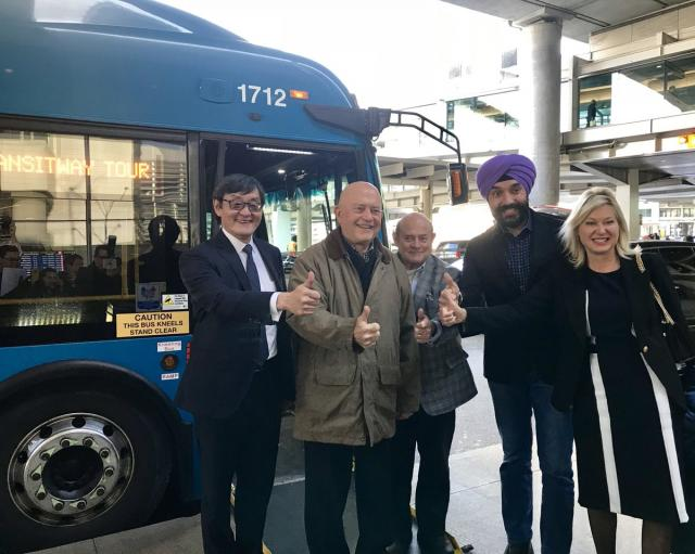 Dignitaries pose before MiWay bus at Pearson