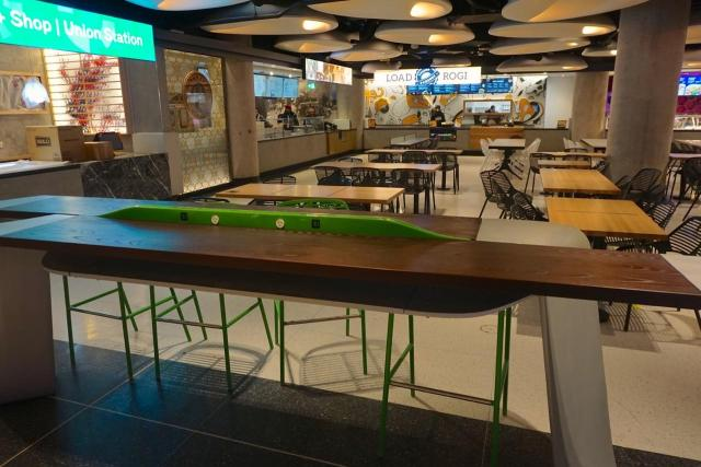 Wow and steel bar-height tables with sockets, Union Station Food Court, Toronto